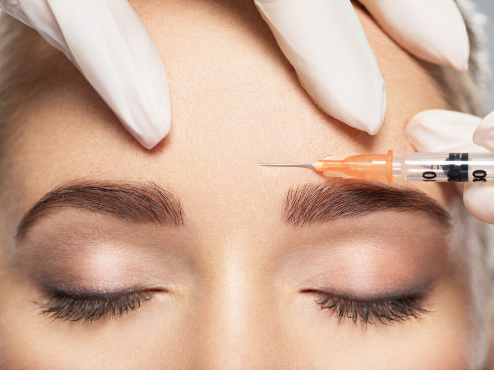 Botox injection into forehead