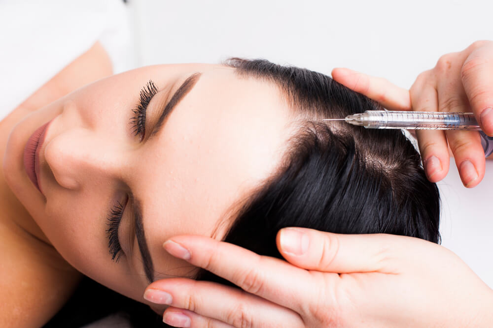 Botox injection in forehead on woman