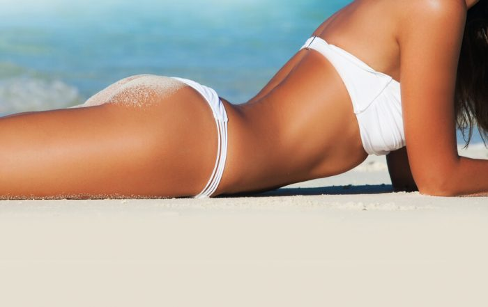 Woman on beach with summer body