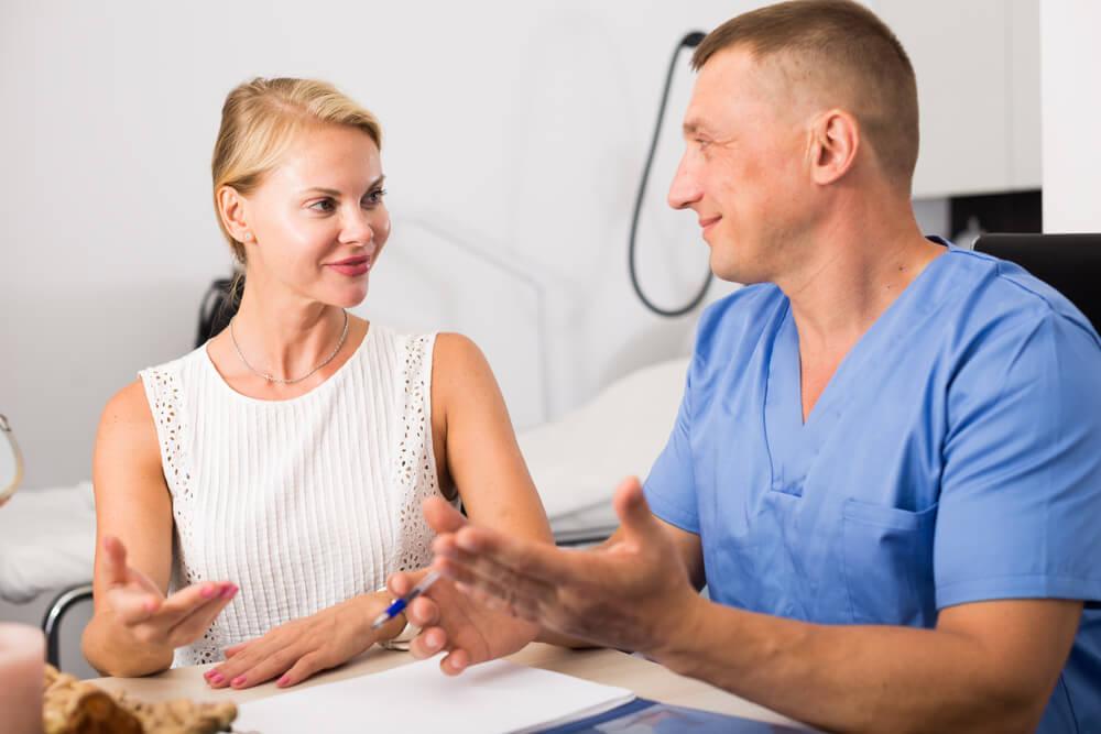 Woman talking to dermatologist