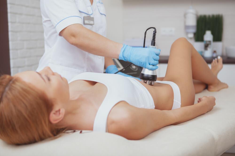 Woman having body sculpting treatment