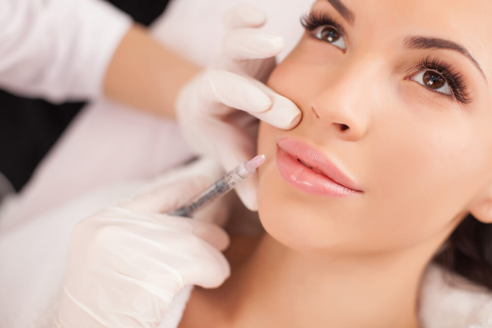 Woman having Botox applied to face