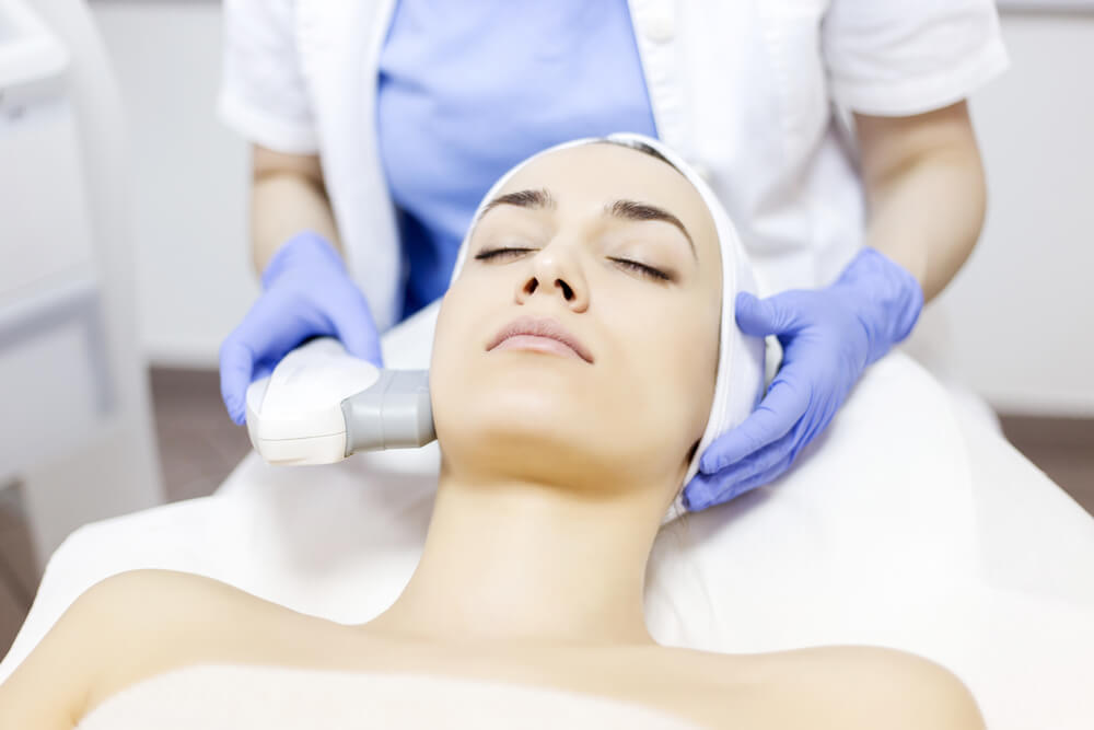 Exilis on woman's face in spa