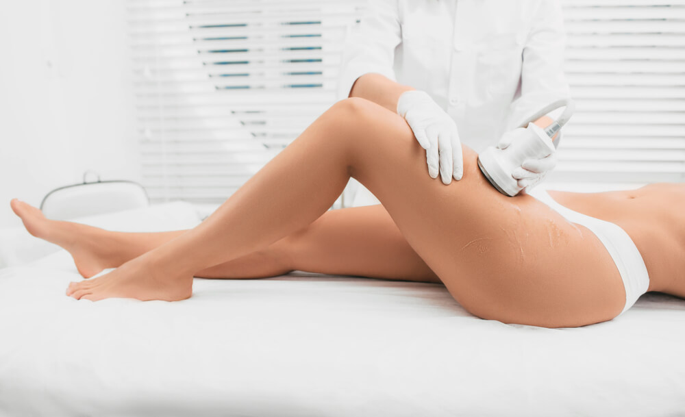 Ultherapy being performed on a woman's thigh