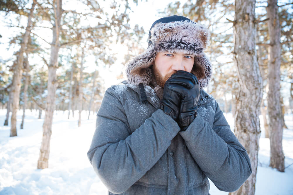 Man outside in cold winter