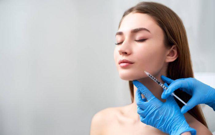 Woman having filler treatment
