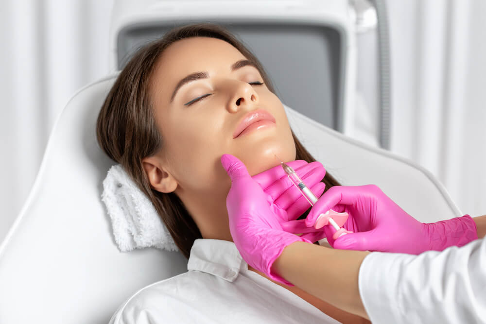 Woman having filler in chin