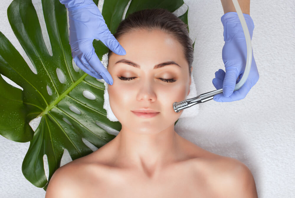 Woman having microdermabrasion treatment