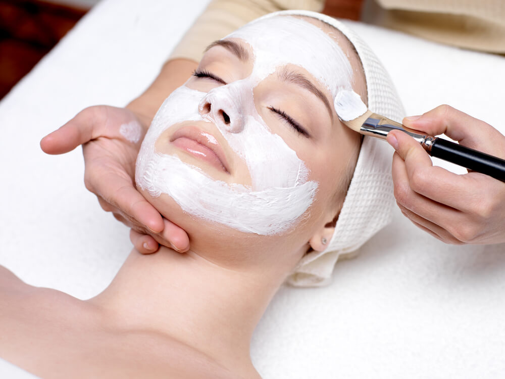 Woman having brightening facial