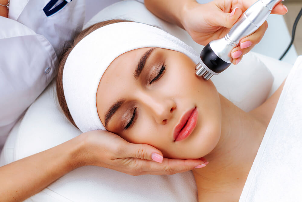 Woman having RF treatment as part of brightening facial