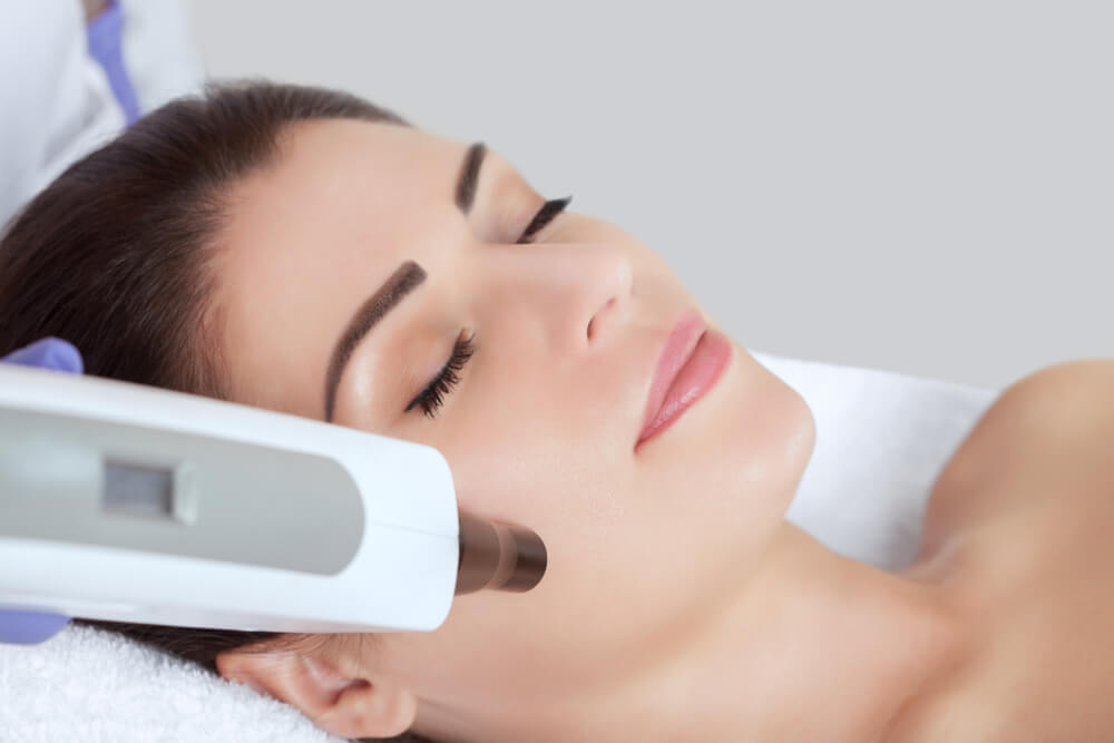 Woman having laser skin treatment