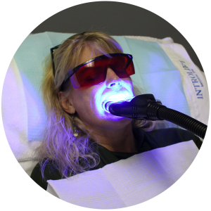 Teeth Whitening treatment on woman
