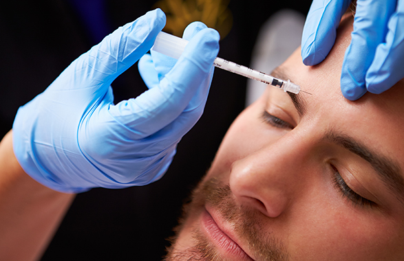 Botox applied to a man's forehead