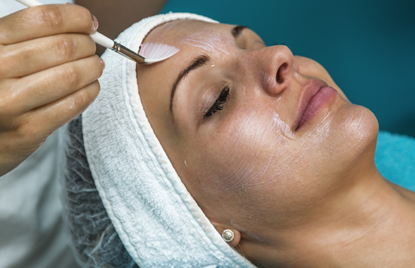 woman getting chemical peel treatment close view