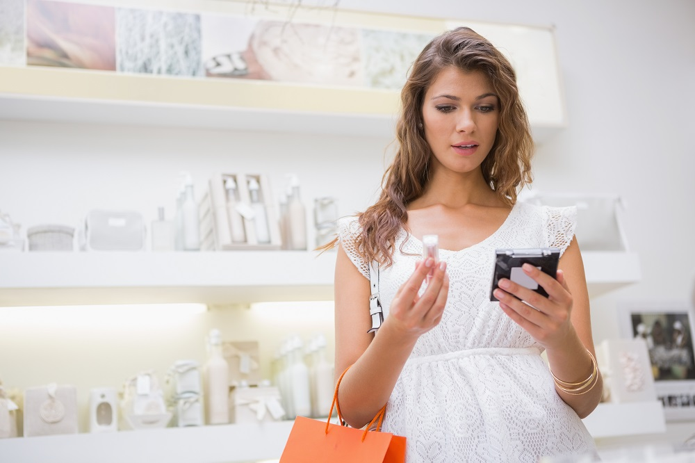 woman reading skin care labels in a store