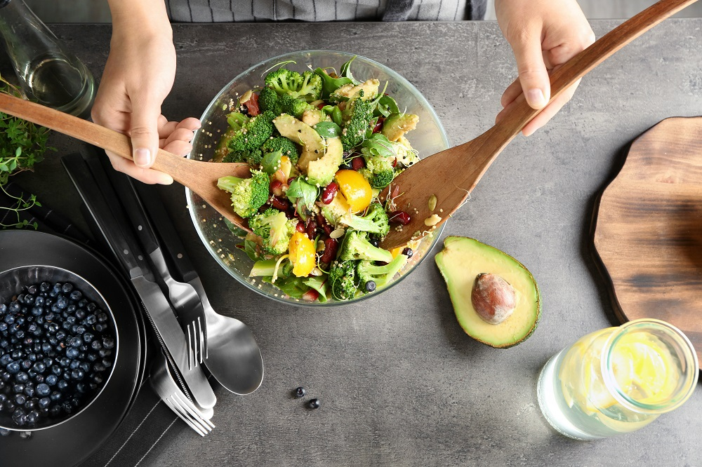 bird's eye view of person mixing colorful salad